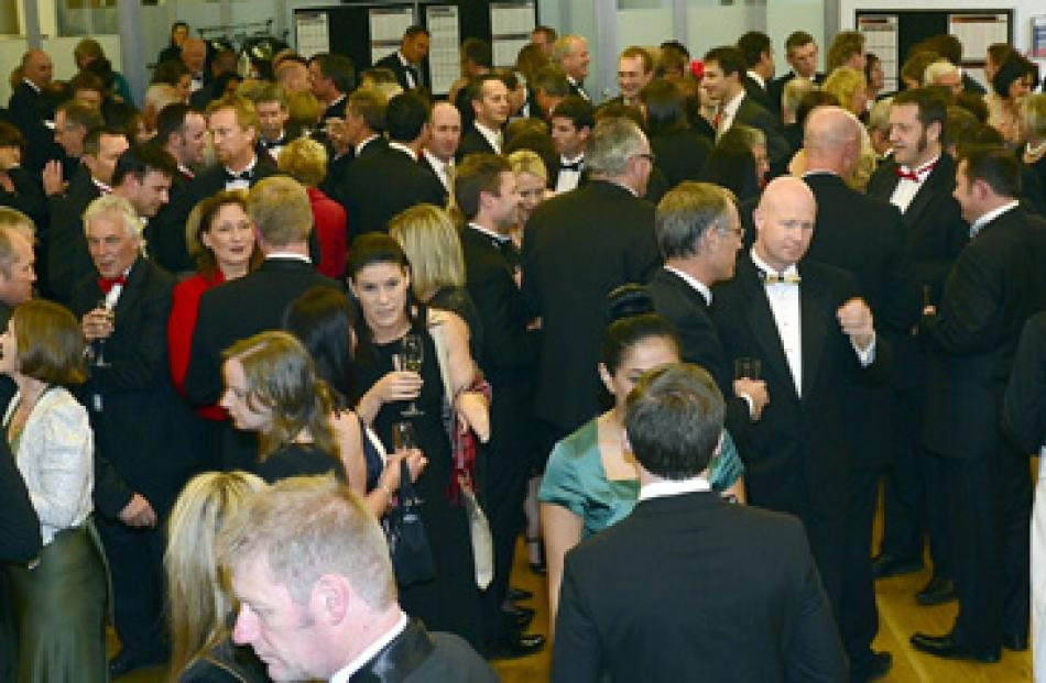 Businesspeople mingle at the function.