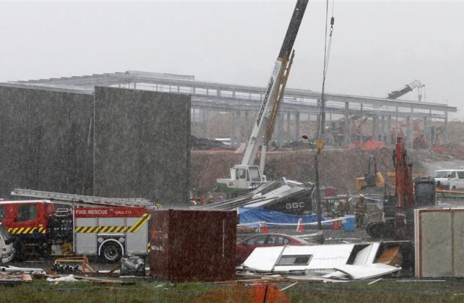 The building site where three workers were killed in yesterday's tornado. Photo Reuters.
