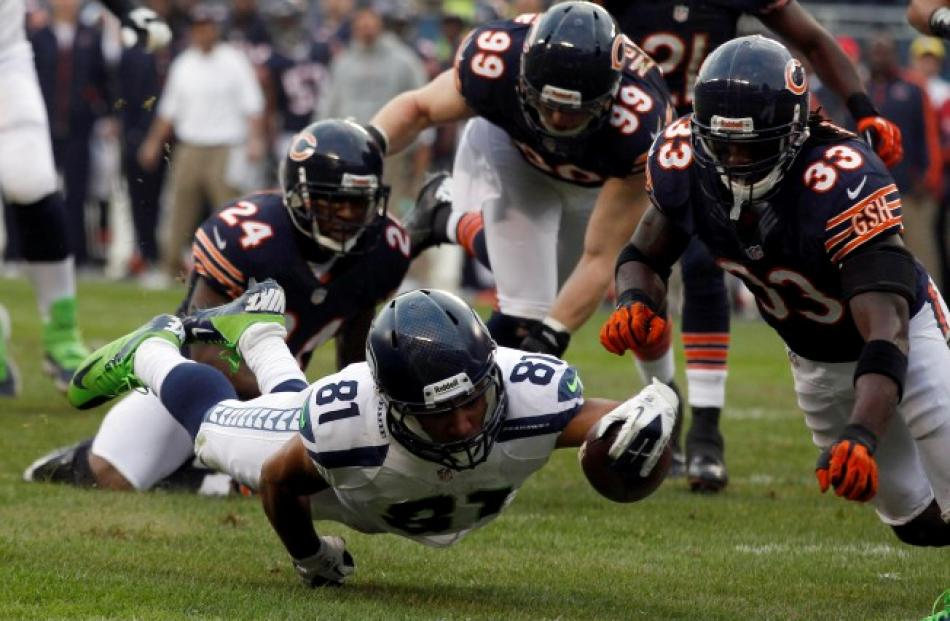 Seattle Seahawks wide receiver Golden Tate (81) dives in for a touchdown past Chicago Bears...