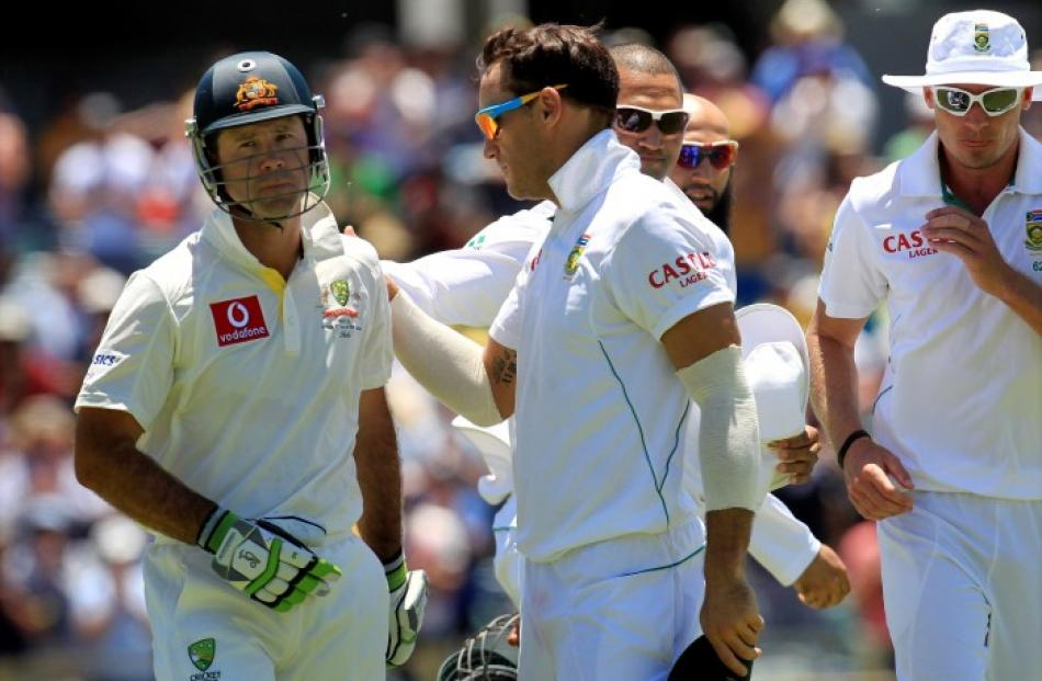 South Africa's Faf du Plessis (C) congratulates Australia's Ricky Ponting (L) after Ponting's...
