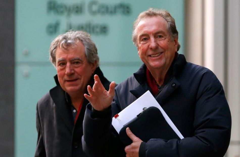 Eric Idle (R) and Terry Jones leave the High Court in London where they are being sued by one of...