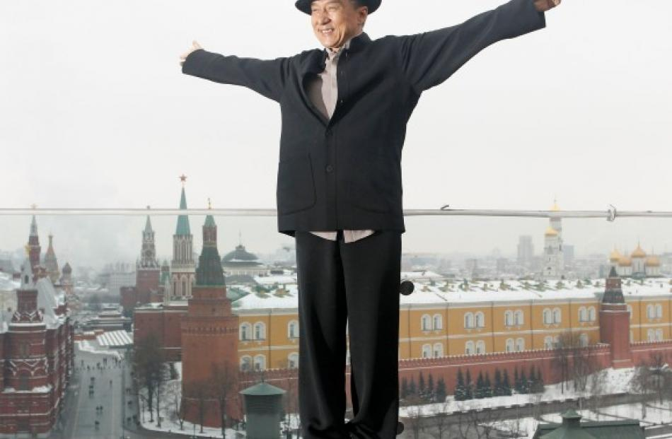 Jackie Chan poses for photographers during a photo call in Moscow for his new film 'Armour of God...