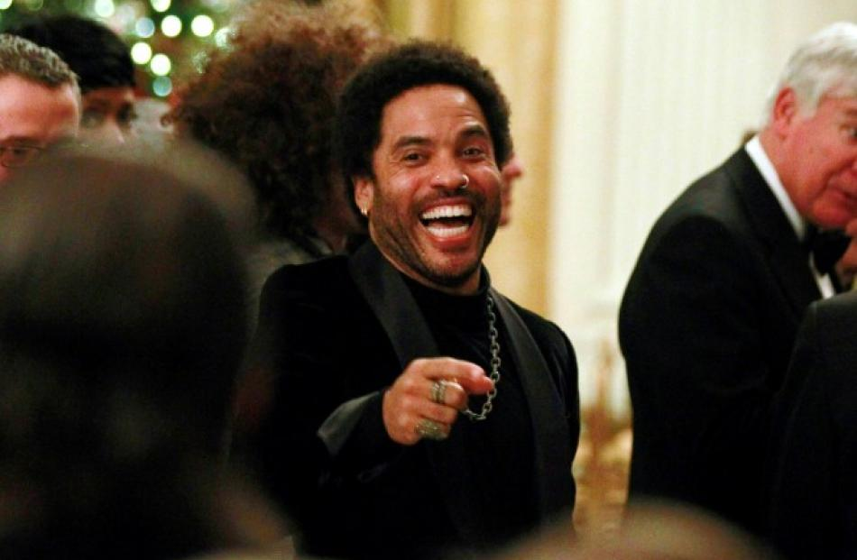 Singer Lenny Kravitz gestures during a ceremony for the 2012 Kennedy Center honorees in the White...