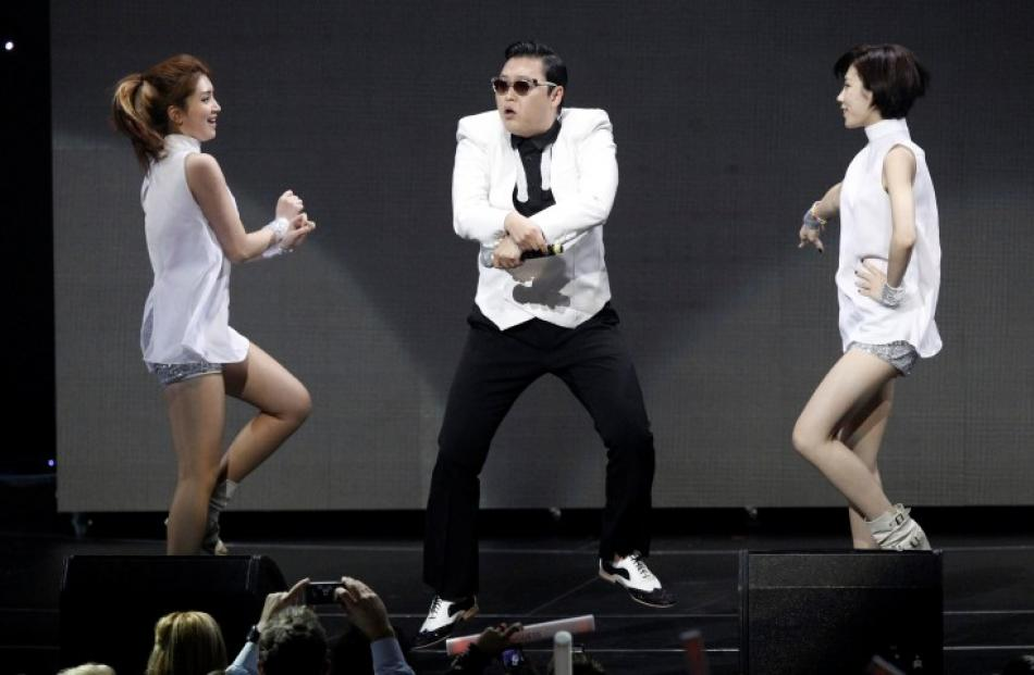 South Korean singer Psy performs at KIIS FM's Jingle Ball concert in Los Angeles, California....