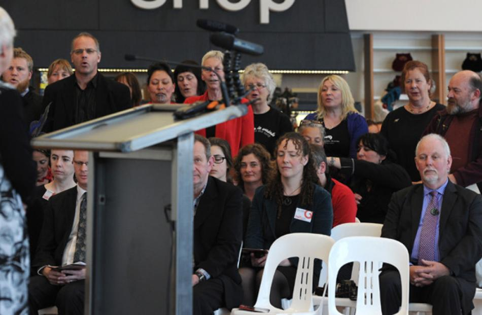 Toitu staff perform a waiata for Dot Page, left, at the opening.