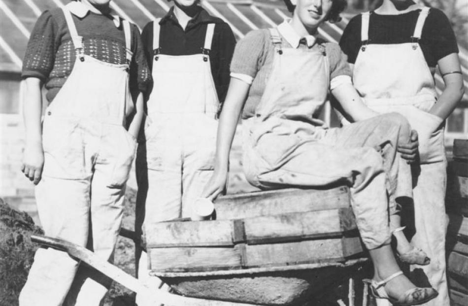 Land girls pose in their work gear. Photo supplied.