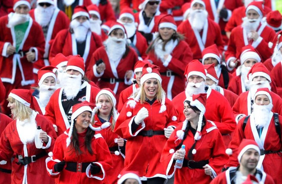 Competitors take part in the annual Great Santa run in the grounds of West Princes Street Gardens...