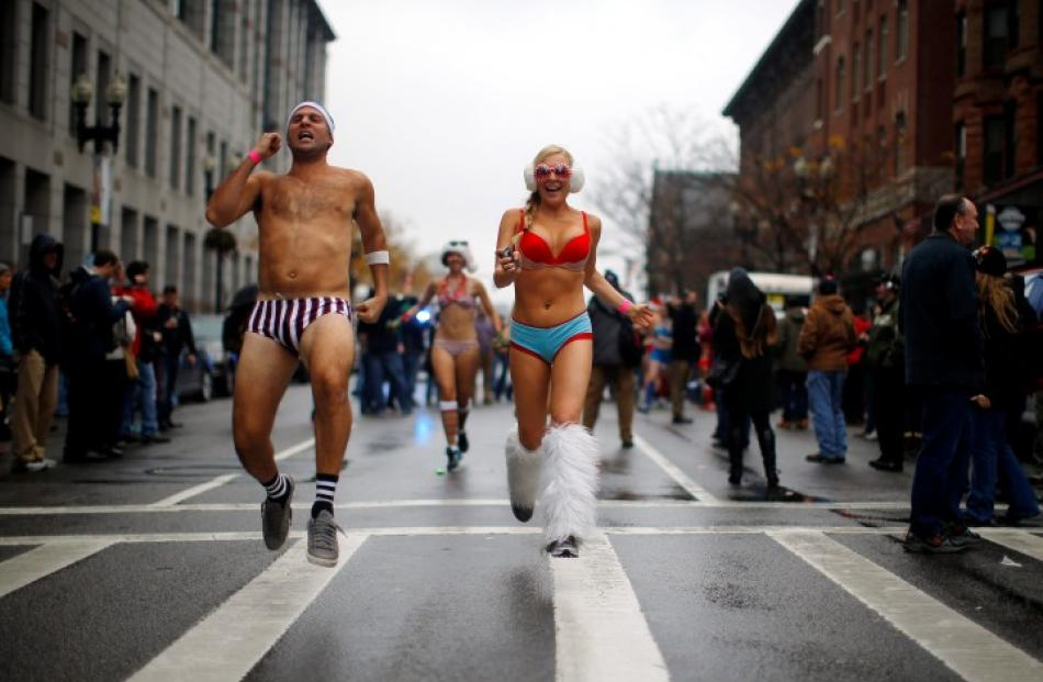 Participants in Boston's annual 'Santa Speedo Run' leave the starting line. REUTERS/Brian Snyder