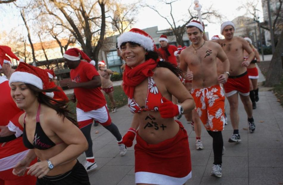 People take part in a half-naked 'Santa run' in downtown Budapest, Hungary. REUTERS/Bernadett Szabo