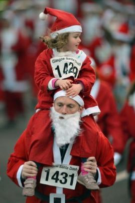 Two people among the 1000 who took part in the annual Santa Dash in Glasgow, Scotland. (Photo by...