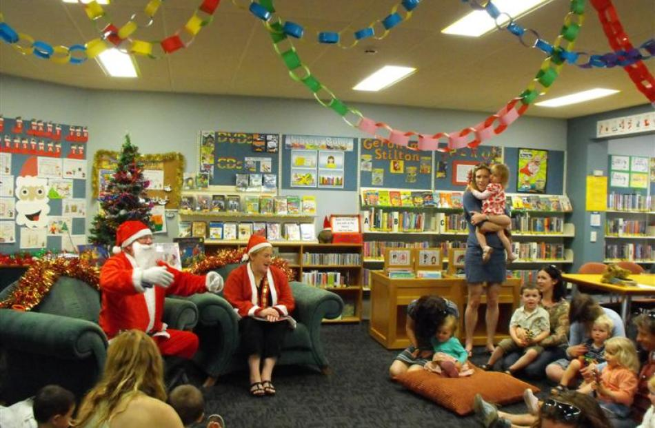 Santa and Mr. Claus kept the crowd of preschoolers entertained at the Queenstown Library.