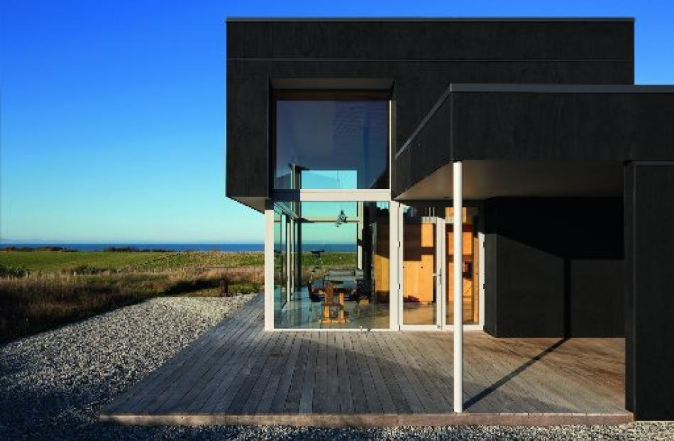 The sophisticated and urbane-looking pavilion by McCoy and Wixon Architects sitting on its...