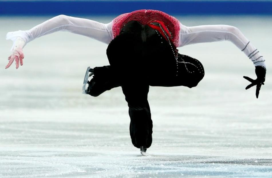 Yuzuru Hanyu of Japan performs during the men's free skating competition at the ISU Grand Prix of...