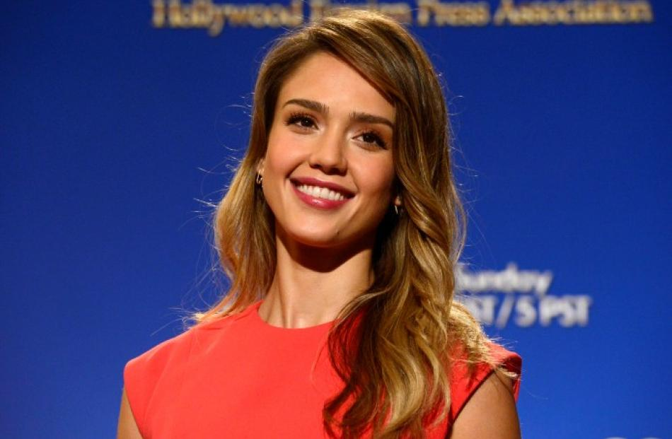 Actress Jessica Alba poses at the announcement of nominations for the 70th annual Golden Globe...