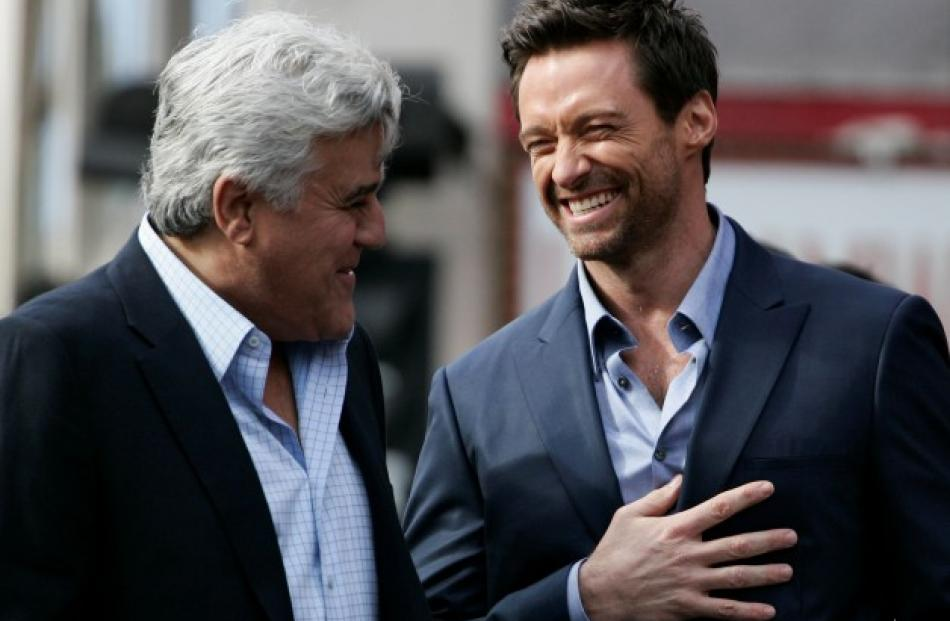 Jay Leno (L) and actor Hugh Jackman laugh during ceremonies honouring Jackman with a star on the...