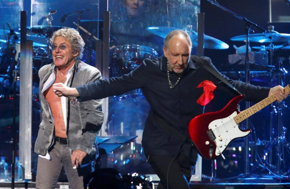 Roger Daltrey (L) and Pete Townshend of The Who perform during the '12-12-12' benefit concert for...