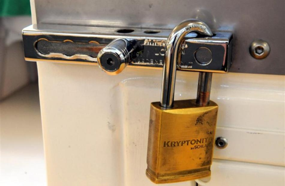 A padlock on a cell door.