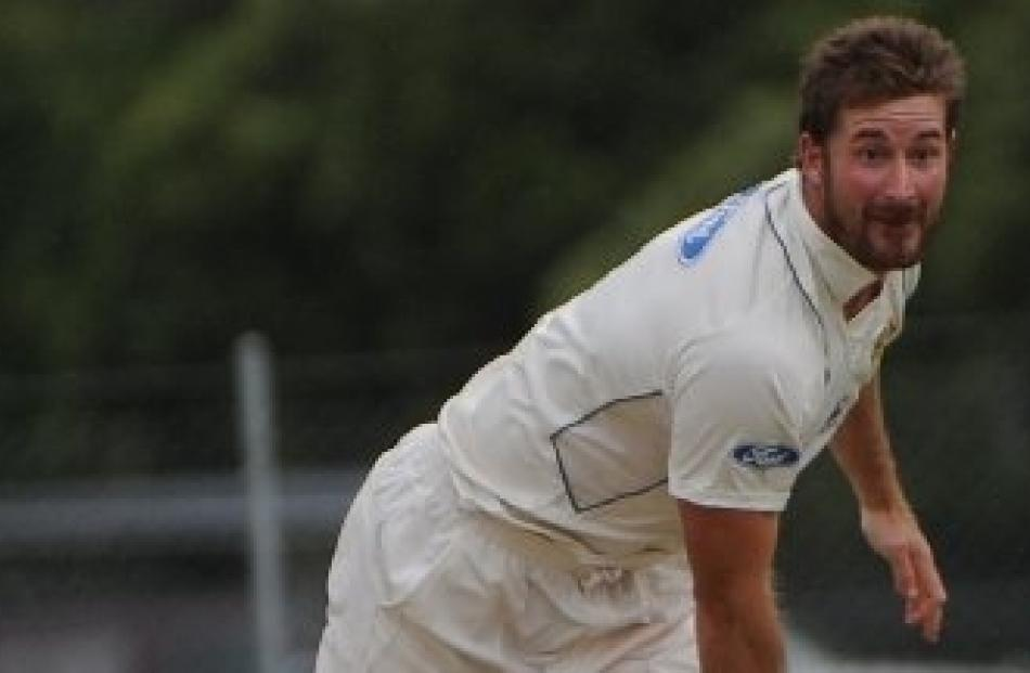 McSkimming on his way to taking five wickets against Auckland during a Plunket Shield match at...