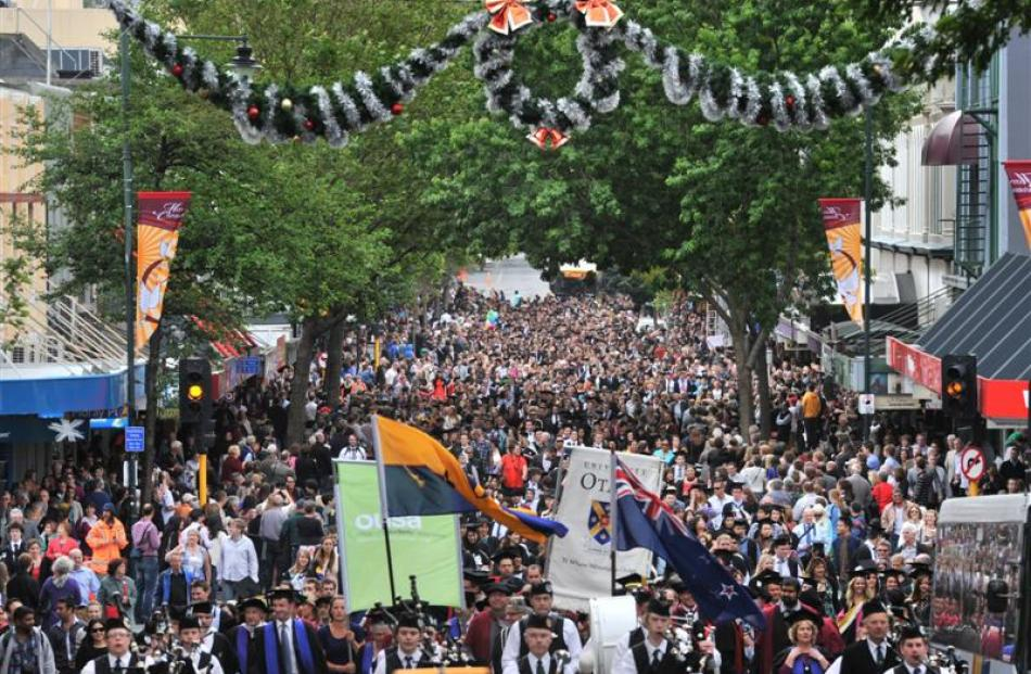 More than 500 University of Otago graduands move along George St, Dunedin, towards the Regent...