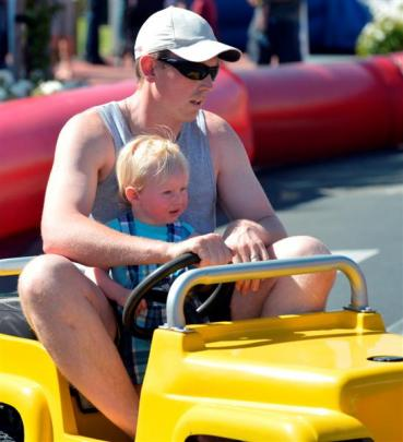 Matt Greene and son Kaian (1), of Dunedin, do a couple of laps.