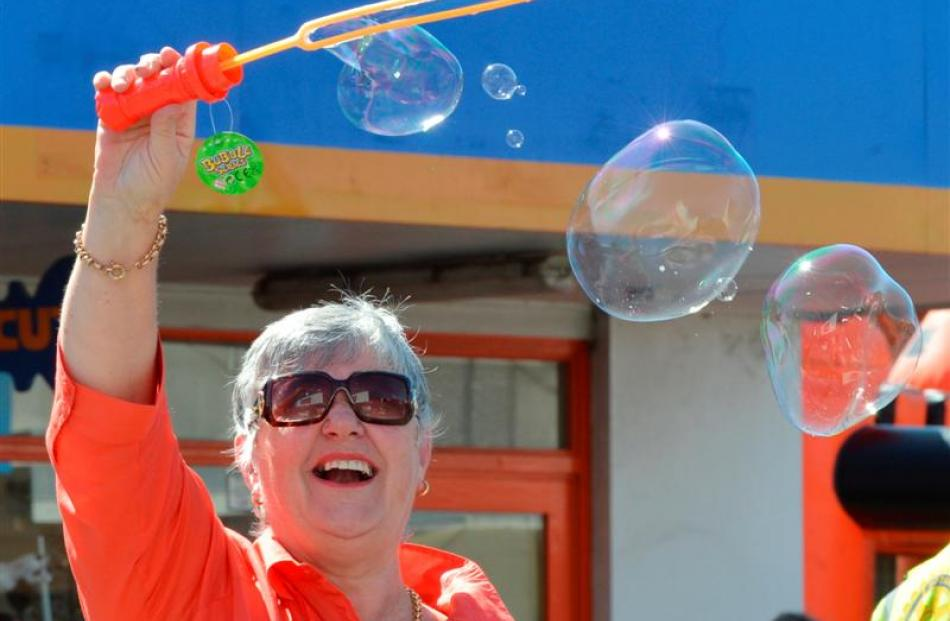 Rotary Club of Taieri member Christine McKay makes bubbles. Photos by Gerard O'Brien.