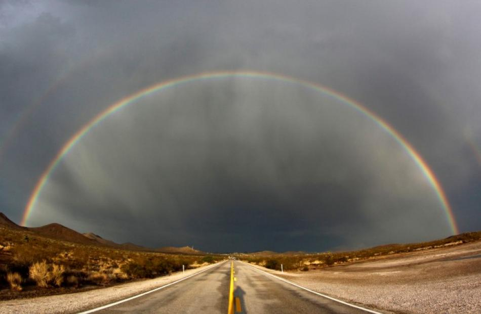 A double rainbow appears after a heavy monsoon storms over Nipton Road in Searchlight, Nevada in...