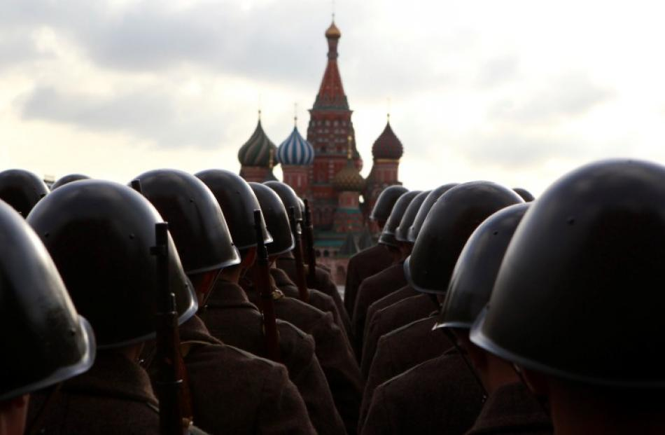 Russian servicemen in historic uniform take part in a military parade rehearsal in Red Square,...