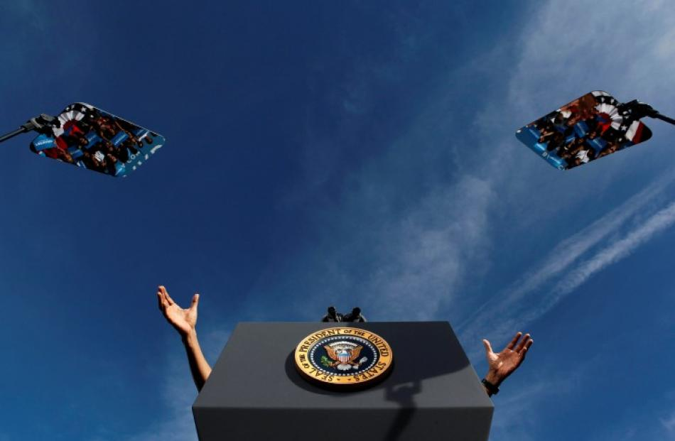 The hands of US President Barack Obama are seen with his teleprompters at a campaign event at...