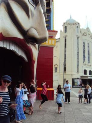 Families emerge from a Sunday afternoon spent in Luna Park amusement park, next to the grand...