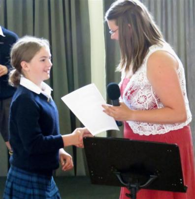 Mackenzie Shewan (10) is congratulated by senior classroom teacher Marlene van Tonder.