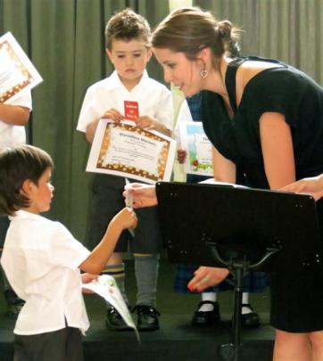 Noah Novacek (5) receives his salutation from principal Rebekah Key.