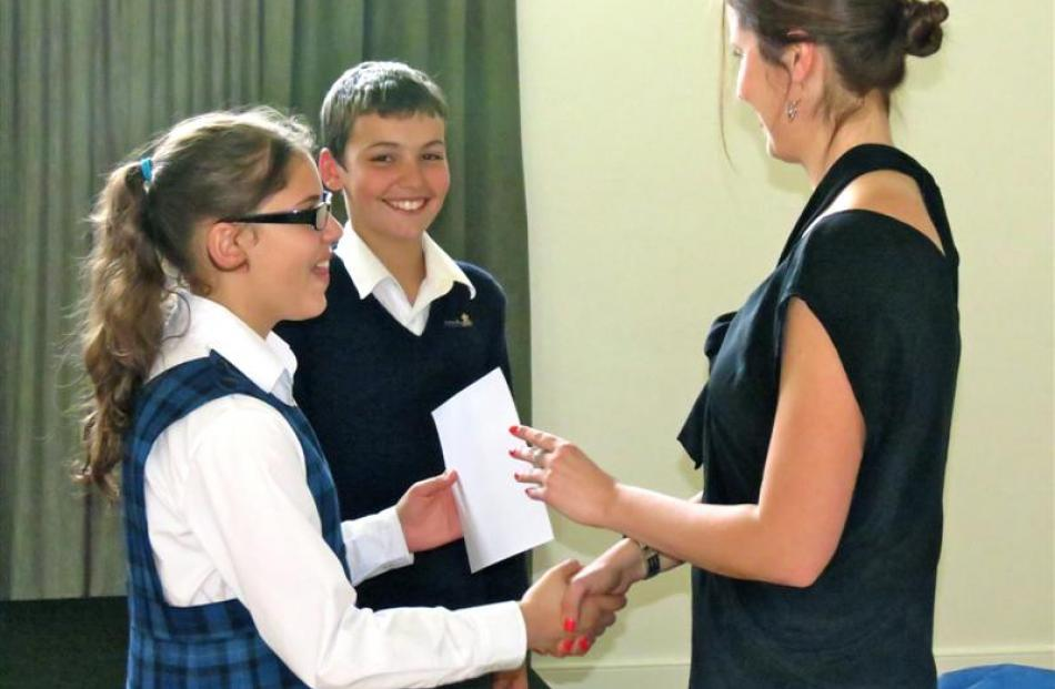 Pupils Nicoli D'Alves (13) and Ben Nicol (12) are given a fond farewell by principal Rebekah Key.
