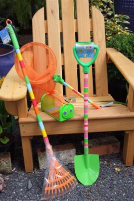 4. Bright selection of American-designed tools; Shovel $34.95, rake $34.90, net $16.90, bug house...