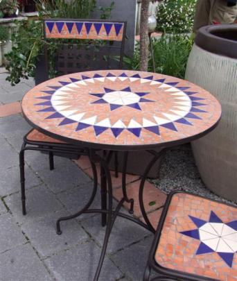 6. Mosaic table and two chairs; From Nichol's Dunedin, $299 the set.