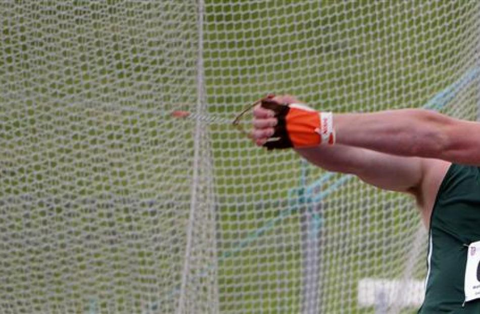 Matthew Bloxam, of Orewa College, competes in the senior boys hammer throw during the New Zealand...