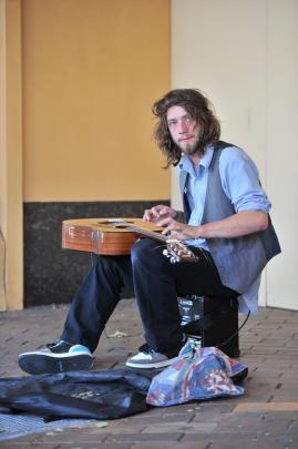 Benjamin Hinch busks on George St on Saturday afternoon.
