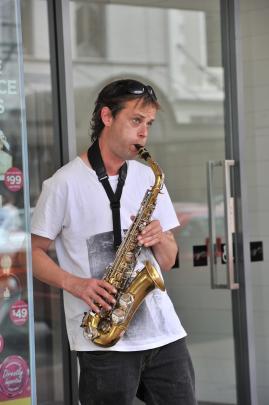 Jason Barrett plays the saxophone on George St.