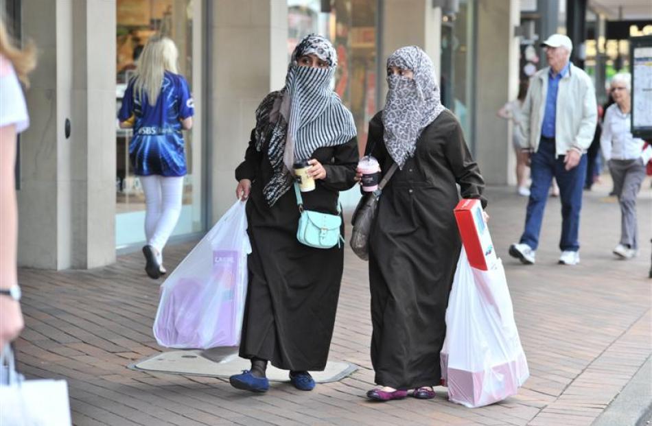 Noorah Ibrahim and Hawazen Alataibi, of Saudi Arabia, enjoy Christmas shopping on Saturday...