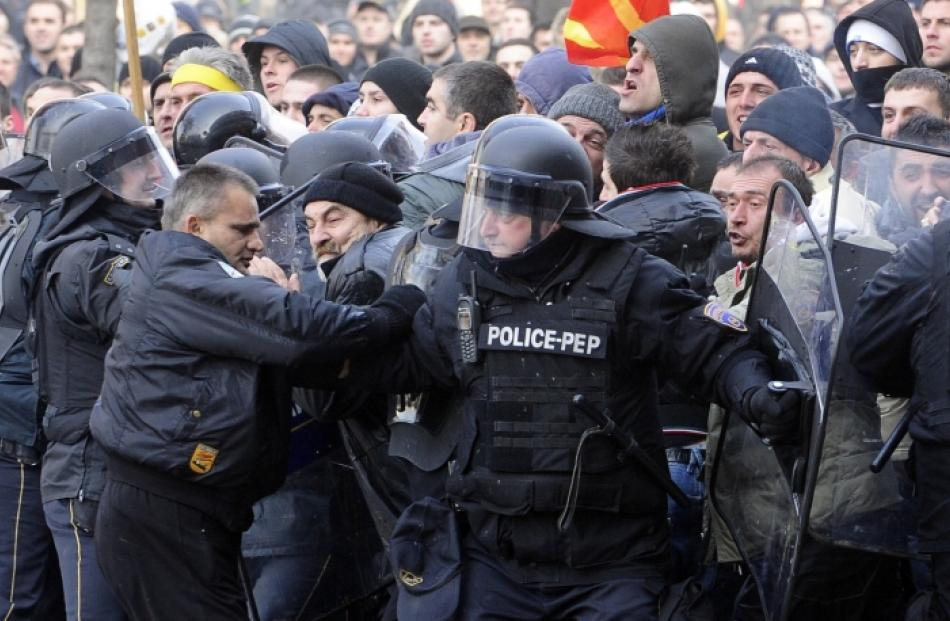 Police confront protestors in front of Macedonia's parliament building in Skopje. Photo by Reuters.
