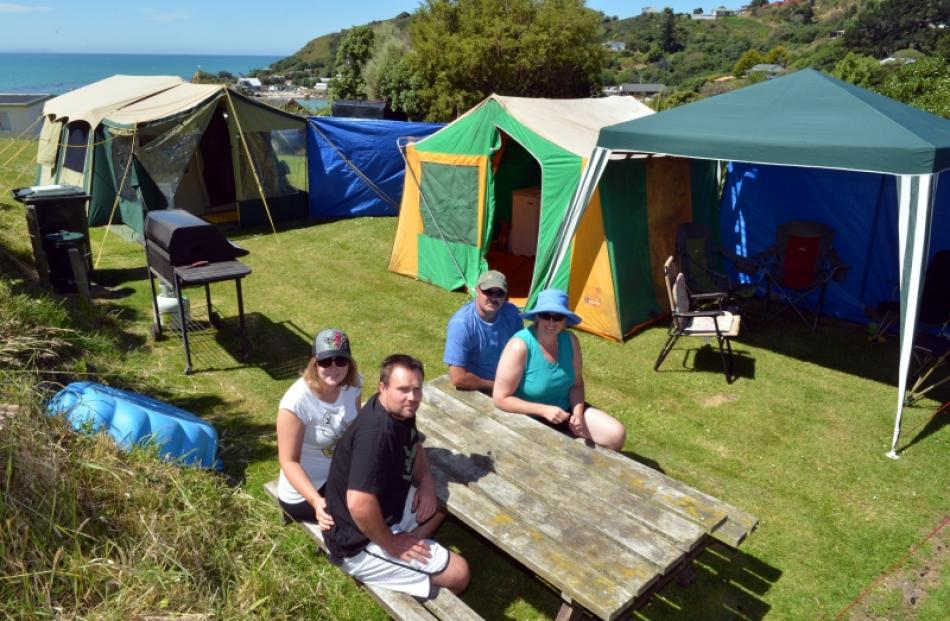 Idyllic ... Christchurch couple Charlotte and Ray Greaves (left) relax with friends Gary and...