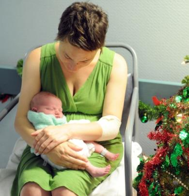 Sarah Moore, of Roxburgh, with her Christmas baby. Photo by Craig Page