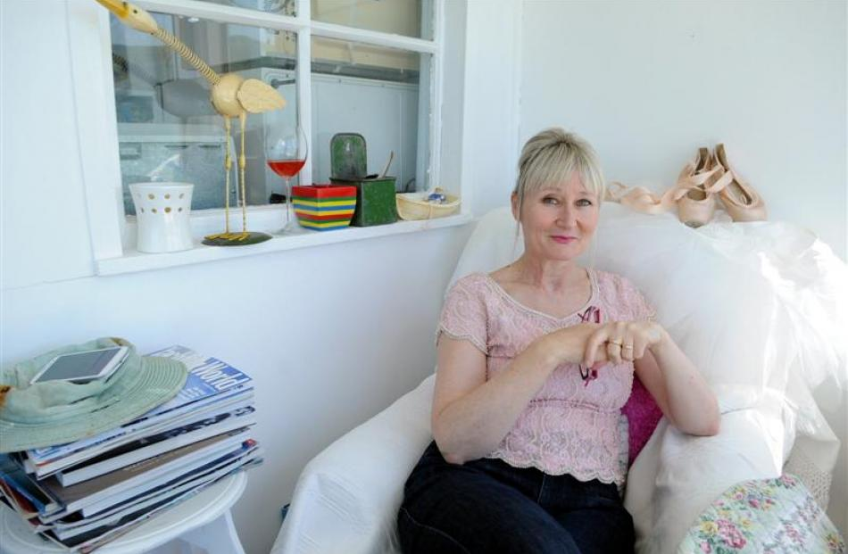 Dunedin collector Lyndall Frost relaxes among some of her treasured finds, displayed in the...