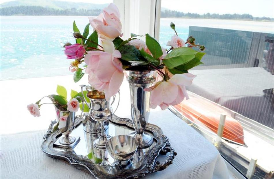 Silverware and flowers decorate a table.
