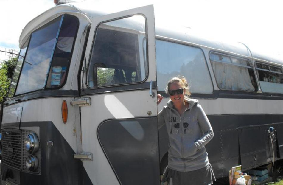 Camping ground resident and manager Suzan Spoelstra stands outside the old bus from Riverton...