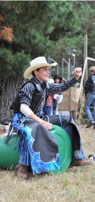 Brendon Johnston (12) of Ashburton practises riding on an empty barrel.