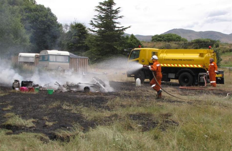 Central Otago Rural Fire Officers Ken Butcher (left) and Mark Davidson, both of Tarras,...