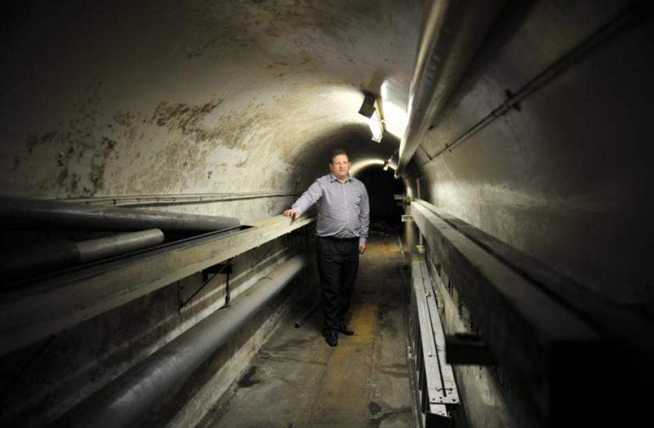 Speight's tour manager Chris Snow explores a 25m tunnel under Rattray St linking the brewery with...