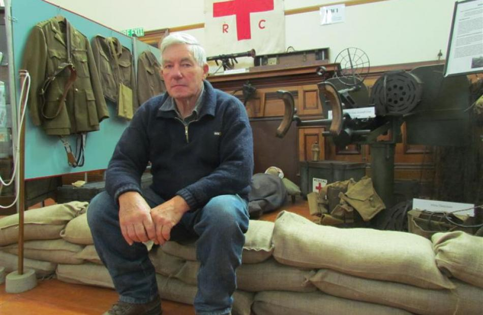 Murray Dempster with his military collection.