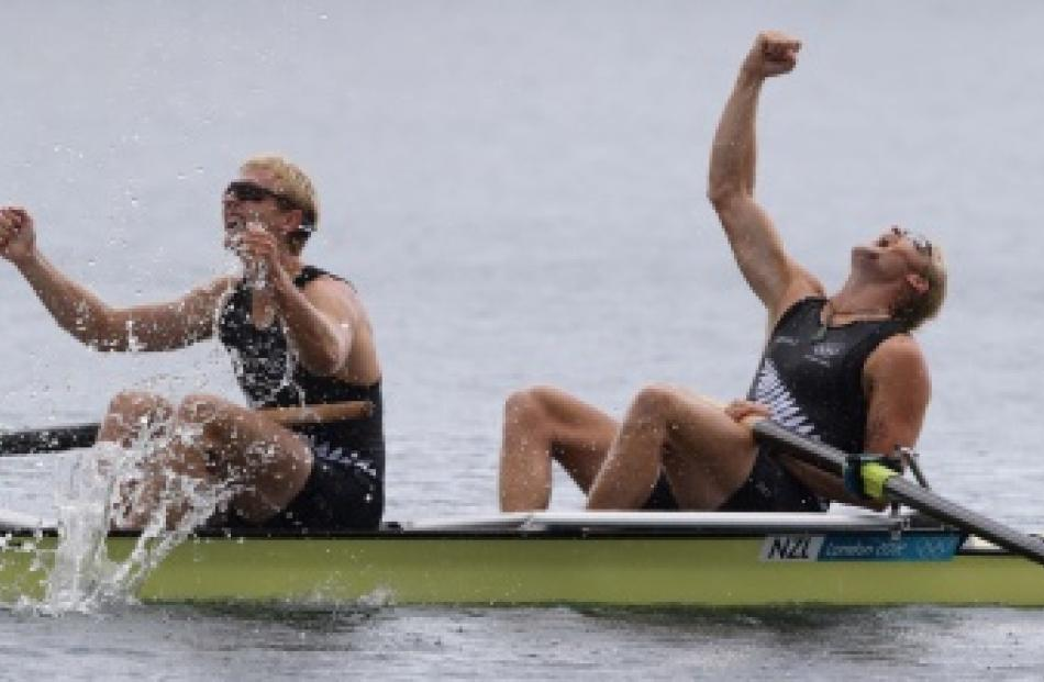 Hamish Bond and Eric Murray celebrate winning gold in the men's pair at the Games. Photo by The...