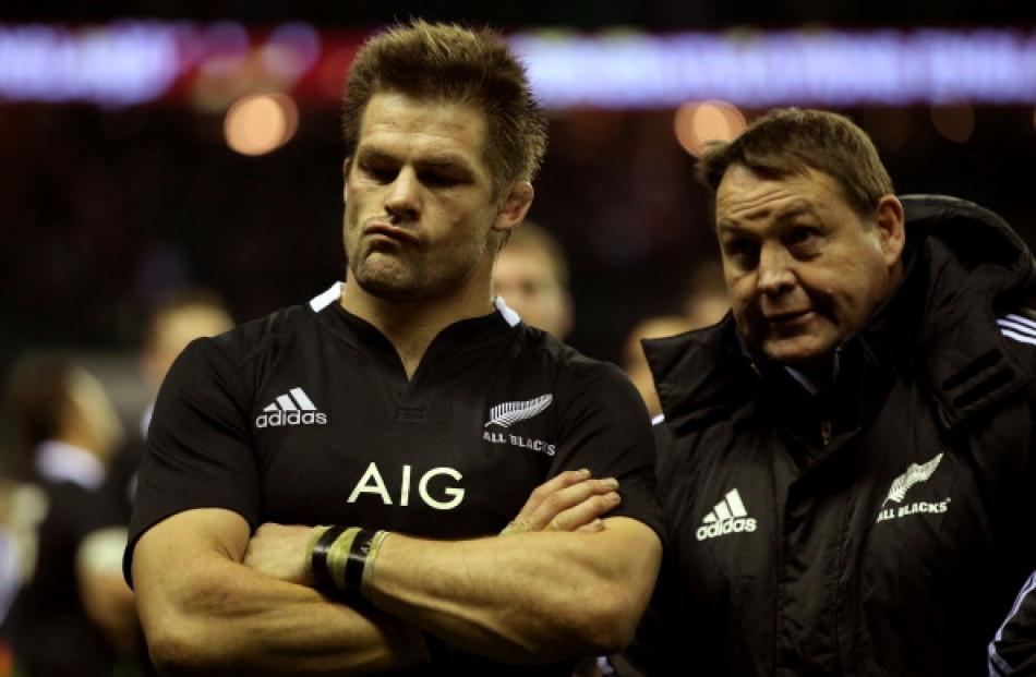 All Black captain Richie McCaw (L) and coach Steve Hansen reflect on their loss to England at...